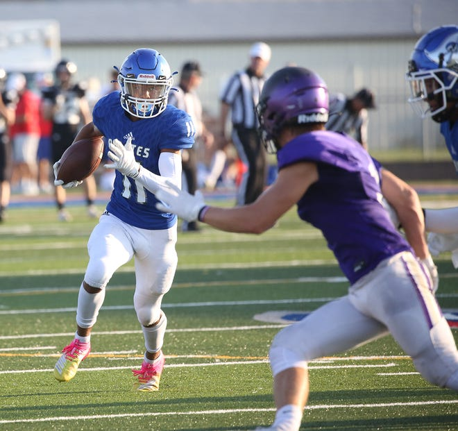 Boonville sophomore Dakota Troost picks up big yardage on a jet sweep against Hallsville Friday night during a Jamboree at Larry K. Noel Spartan Stadium in Moberly.