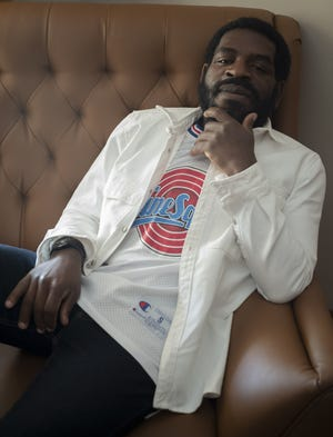 Author and poet Hanif Abdurraqib poses for a portrait on Monday, July 12, 2021 at his home in Columbus.
