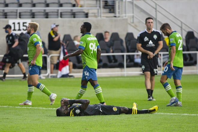 Crew defender Jonathan Mensah lies on the field at the end of a 2-1 loss to the Seattle Sounders. Columbus has lost six straight.