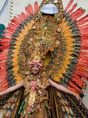 Cherilyn Chow displays a colorful costume at the Indonesian Festival Saturday, Aug. 21, 2021 in Somersworth.