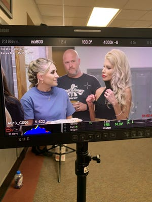 """Craig Janssen, owner of Great Harvest Bread Co. locations in Morton and Peoria, interacts with actors Alix Kermes, left, and Stefanie Bloom in a scene from """"Baking Up Love."""""""
