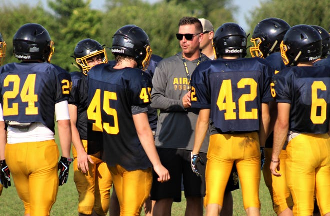 Airport coach Jim Duffy gives instructions to his team during a preseason practice last week.