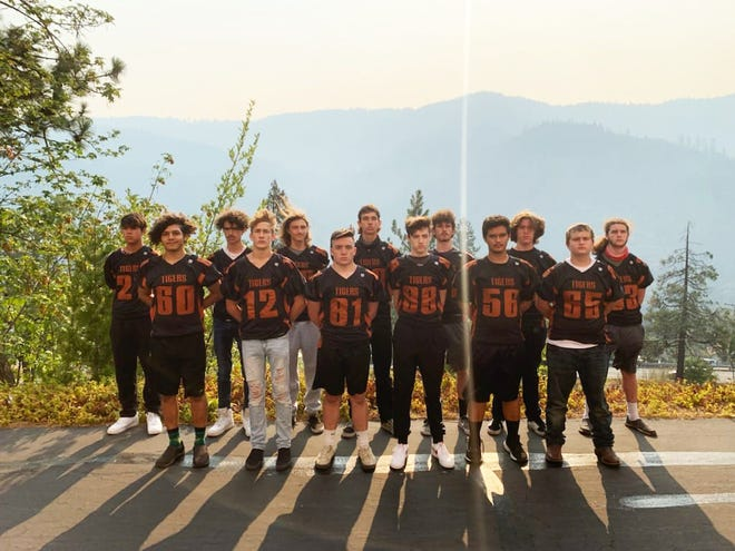 Members of this year's Dunsmuir Tigers football team pose for a photo.