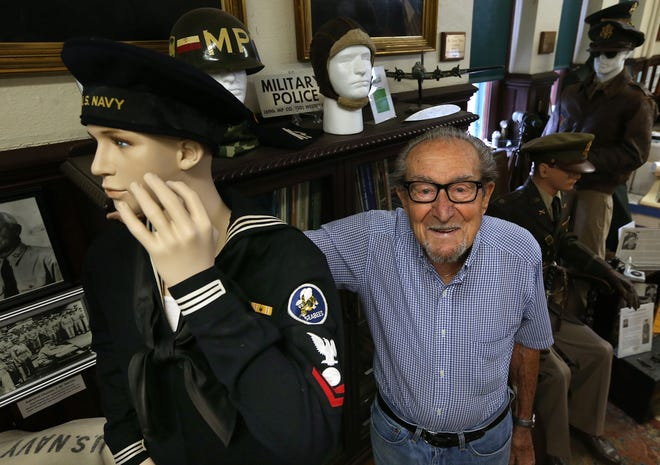 Ernie Cassis, 96, stands next to his Seabee uniform on display at the Westerly Armory. Cassis served in the Pacific as an electricians mate 2nd class with the Seabees during WWII.