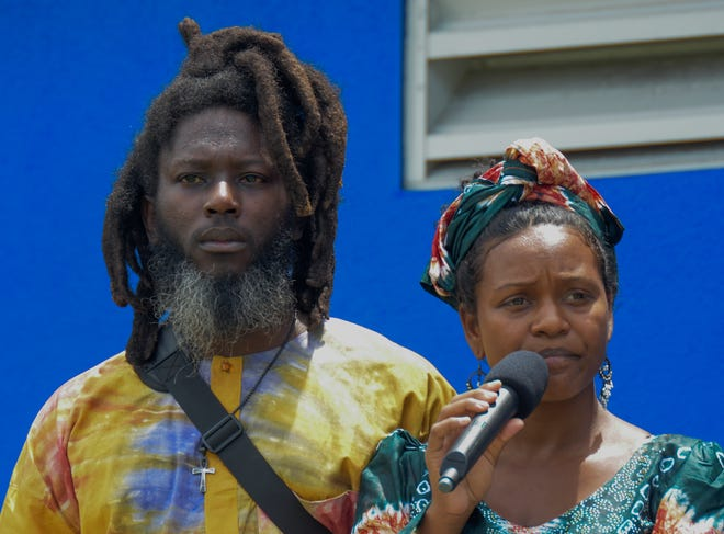 """Syesha Mercado, right, a former """"American Idol"""" finalist, and her partner, Tyron Deener, speaking at a rally in Sarasota on Aug. 22 organized by Black Lives Matter Manasota to bring attention to their efforts to win back custody of their son, Amen'Ra."""