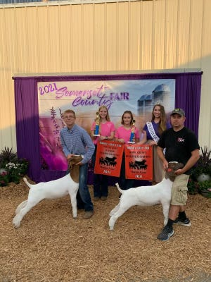 Reserve Homegrown and County Bred Market Goats Noah Lehman (left), 16, of Boswell area, won both Reserve Champion Homegrown Market Goat and Reserve Champion Somerset County Bred Market Goat at the competition on Saturday evening. He is the son of Nathan (right) and Michelle Lehman. He is a tenth-grader at Conemaugh Township High School and a member of Dairydells 4-H Club. Also shown are outgoing fair queen Abigail Knapp and this year's contestants Abby Shuck and Bruck Ohler.