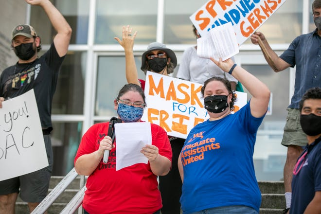 Graduate students and professors protest the University of Florida not requiring masks on the steps of Tigert Hall in Gainesville on Aug. 20.
