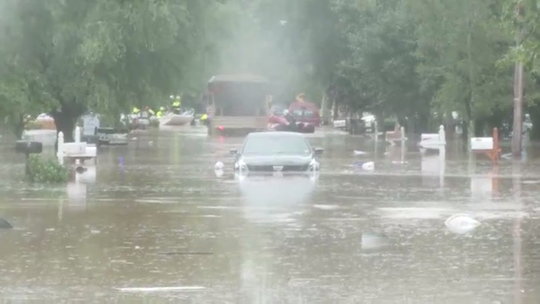 Residents being a evacuated due to massive flooding from tropical storm Henri
