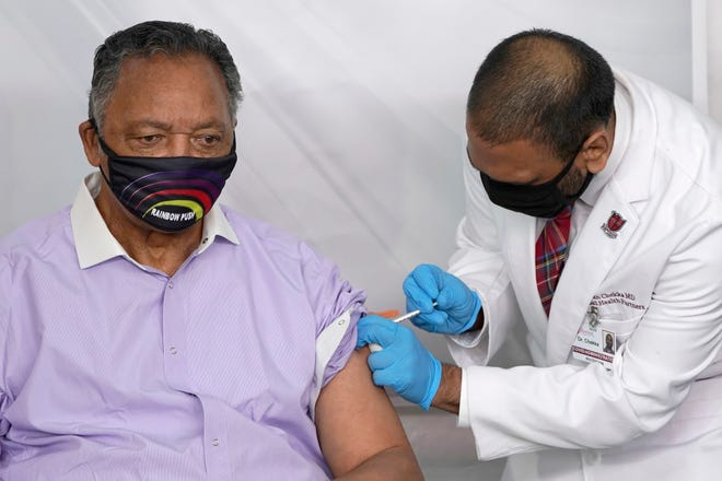 In this Friday, Jan. 8, 2021 file photo, Rev. Jesse Jackson receives the Pfizer's BioNTech COVID-19 vaccine from Dr. Kiran Chekka, Covid Administration Physician at the Roseland Community Hospital in Chicago.