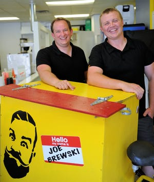 Nate Templeton, left, and Dustin Whobrey, stand inside the new storefront of Joe Brewski, the coffee company that Templeton started only three years ago with a cooler and a big tricycle, on Friday, Aug. 20, 2020.