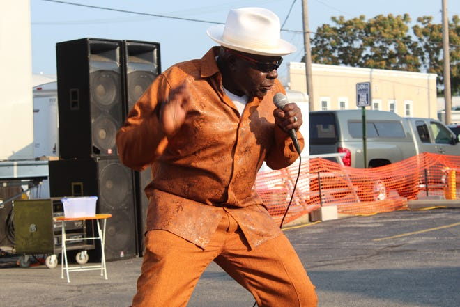 Robert Lee Gray, known by his stage name of Bobby G, performs with the Third Street Cigar Blues Band at Fremont Rotary Club's fifth annual Blues, Brews and Brats Festival, held Saturday in downtown Fremont.
