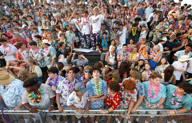 Christian Brothers students cheer on their team from the stands as they take on Germantown at CBHS on Saturday, Aug. 21, 2021.