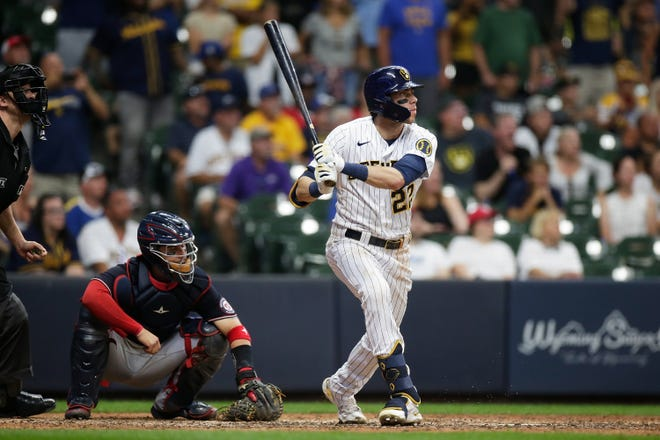 Brewers leftfielder Christian Yelich watches a grand slam fly out of the park in the eighth inning Saturday against the Washington Nationals at American Family Field.