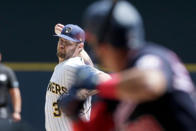 Brewers starter Adrian Houser allowed three hits, an unearned run, two walks and also hit a batter while striking out a pair in 3⅓ innings Sunday in his return from the COVID-19 injured list.