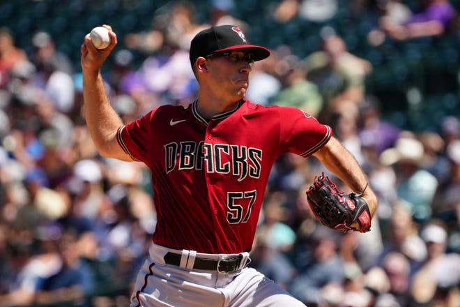 Aug 22, 2021; Denver, Colorado, USA; Arizona Diamondbacks starting pitcher Taylor Widener (57) delivers a pitch in the first inning against the Colorado Rockies at Coors Field. Mandatory Credit: Ron Chenoy-USA TODAY Sports