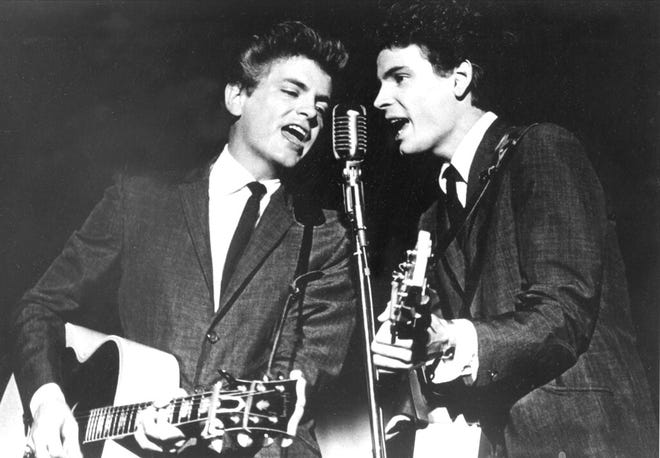 FILE - In this July 31, 1964 file photo The Everly Brothers, Phil, left, and Don, perform on stage. Don Everly, one-half of the pioneering rock 'n' roll Everly Brothers whose harmonizing country rock hits impacted a generation of rock music, has died.  Don Everly was 84. According to the LA Times, a family spokesperson said Everly died at his home in Nashville, Tennessee on Saturday, Aug. 21, 2021. (AP Photo, File)