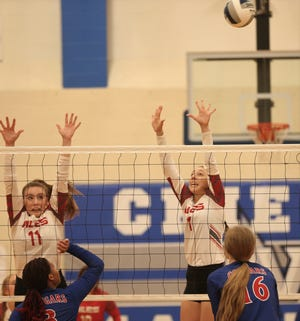 Miles High School's Allie Kalina, 11, and Jessica Hinds try to block a shot by Abilene Cooper at the Nita Vannoy Memorial Volleyball Tournament in San Angelo on Saturday, Aug. 21, 2021.