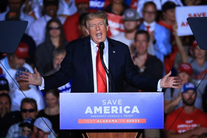 """Former U.S. President Donald Trump addresses supporters during a """"Save America"""" rally at York Family Farms on August 21, 2021 in Cullman, Alabama."""