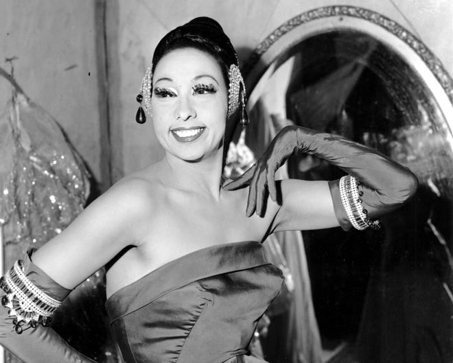 In this file photo dated March 6, 1961, singer Josephine Baker poses in her dressing room at the Strand Theater in New York City. (AP Photo)
