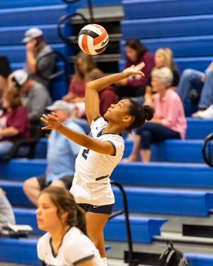 Hendrickson setter Karys Dove, serving against Georgetown in a match earlier this month, led the Hawks to the tournament title in Bastrop this weekend.