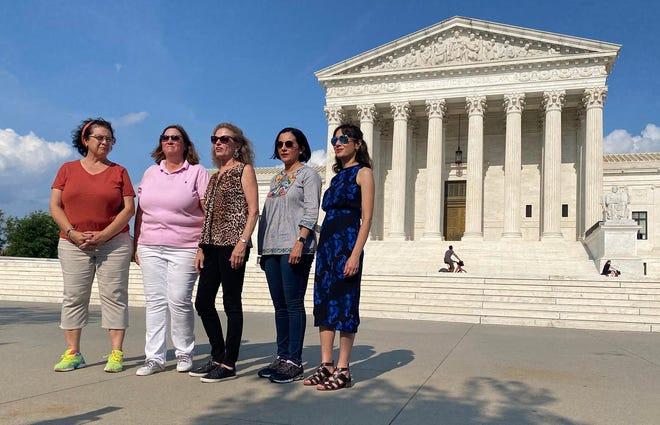 Texas House Democrats Celia Israel, Julie Johnson, Donna Howard, Ina Minjarez and Gina Hinojosa speak outside the U.S. Supreme Court building on July 15.