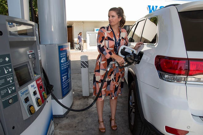 Kelsey Oliver puts gasoline in her vehicle at a station on South Congress Avenue on Monday. The average price for a gallon of regular unleaded gasoline in Austin has dropped 4.6 centsin the past week, dipping to$2.73,according toindustry website GasBuddy.