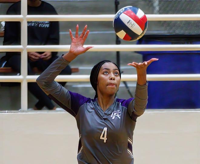 Cedar Ridge junior Nyla Lewis, serving the ball against Austin High last week, said beating Vista Ridge last season is her greatest memory as a high school volleyball player.