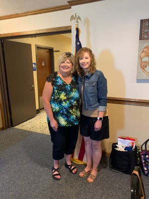 Char Loar of the Alliance Jane Bain Chapter of National Society Daughters of the American Revolution, greeted Katie Kellams, a fifth-grade teacher at Lexington Elementary School.