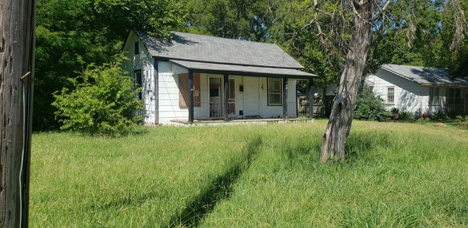 Overgrown lawns such as this one at a condemned house in Northwest Ardmore are havens for insects and vermin. Code enforcement are currently issuing notices to the public to cut back the weeds and keep trees above roads and sidewalks trimmed.
