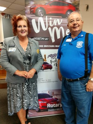 Rotary District 6600 Governot Mary AufdenKampe and Loudonville President Brian Hartzell promote the District Drawing for a 2022 Mustang Mach E SWV AWD drawing the district is conducting to raise money for the Rotary Foundation.