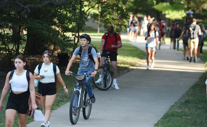 Iowa State University students pass through the university's central campus during the first day of school Monday, Aug. 23, 2021, in Ames, Iowa.