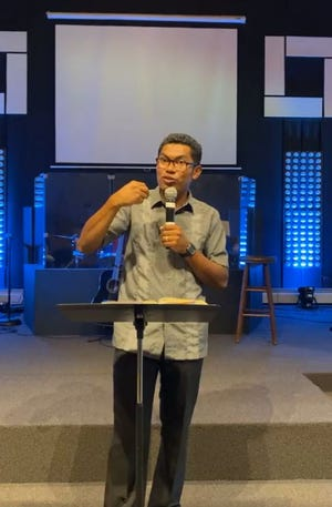 Church Pastor Nahum Martinez preaches during a recent Sunday sermon. The church, which officially opened in November 2020, has Hispanic/Latino attendees from different areas in the county.