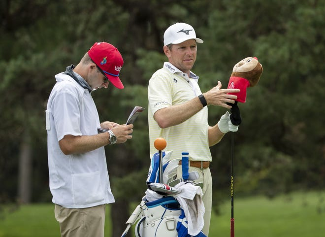 Bo Hoag, seen here taking a Brutus Buckeye head cover off one of his clubs, has committed to play in the Nationwide Children's Hospital Championship this week.