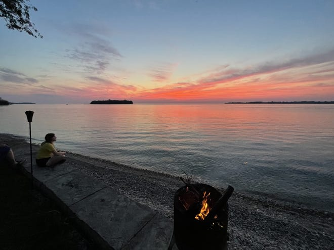 The sun sets beneath the channel between Sugar and North Bass islands.