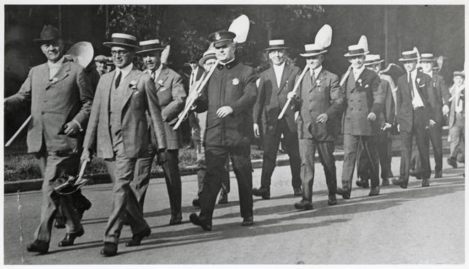 After a $1 million campaign to fund Howard Dwight Smith's design for Ohio Stadium, the early donors were invited to participate in the groundbreaking ceremony Aug. 3, 1921. Gov. Harry L. Davis, the Ohio State University marching band and notable locals, including Ohio State President William Oxley Thompson, led a procession of shovel-wielding fans to the future site of the Horseshoe. Davis was the first to overturn soil at the site before more than 2,500 fans took turns doing the same. The stadium, built by E. H. Latham Co. of Columbus, opened in 1922 with a seating capacity of 66,210.