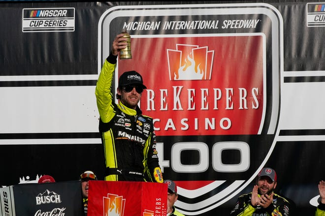 Ryan Blaney celebrates his win after the NASCAR Cup Series FireKeepers Casino 400 at Michigan International Speedway on Sunday. (AP Photo/Carlos Osorio)