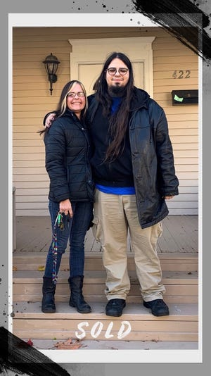 Cara Synder and her son Joaquin Ramos are pictured at their home at 422 S. Winter St. in Adrian on closing day Nov. 7, 2019. Snyder had been chronically homeless since she was 17 years old until a loan from Premier Bank put a roof over her head.