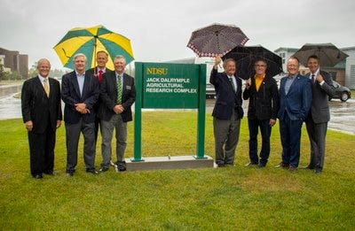 NDSU's state-of-the-art greenhouse complex now is the Jack Dalrymple Agricultural Research Complex. (L to R): NDSU President Dean Bresciani, Senator John Hoeven, Vice President for Agricultural Affairs Greg Lardy, SBARE Chair Mark Birdsall, former Governor Jack Dalrymple, Governor Doug Burgum, Lieutenant Governor Brent Sanford and former Lieutenant Governor Drew Wrigley.