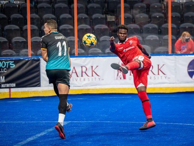 Kansas City Comets midfielder Mike Da Silva, right, tries to volley a shot over Omaha Kings defender Eduardo Suarez (11) during an exhibition match in August at Cable Dahmer Arena. Da Silva, who was on loan from Baltimore at the end of last season, has signed a two-year contract with the Comets.