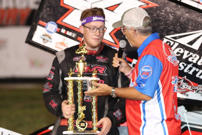 Chris Martin, Ankeny, gets interviewed by race announcer Jeff Broeg, after Martin took the checkered flag in the Sprint Invaders feature at 34 Raceway on Saturday.