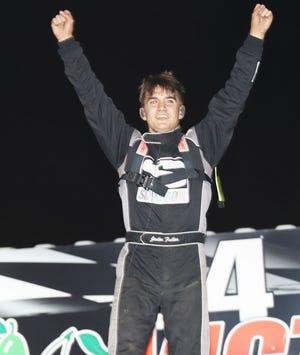 Jadin Fuller, Memphis, Missouri, celebatres his sport mod feature win at 34 Raceway Saturday.