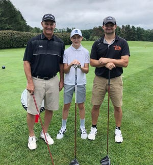 Fathers and sons from three generations pose before their shots on the 10th tee at Gardner Municipal Golf Course last Friday in the Gardner High Basketball Boosters Golf Tournament. From left to right: Pete Gamache Sr., Cam Gamache and Pete Gamache Jr.