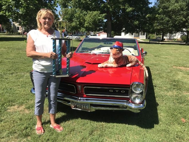 Debbie Johnson of Pekin was chosen by Mayor Rich Volkert for the Mayor's Trophy for her 1965 GTO at Sunday's Galva Freedom Fest Car Show in Galva. All of the proceeds of the show  go to pay for the Freedom Fest activities each year in Galva. There were 130 entries in this years show in Galva's Wiley Park.