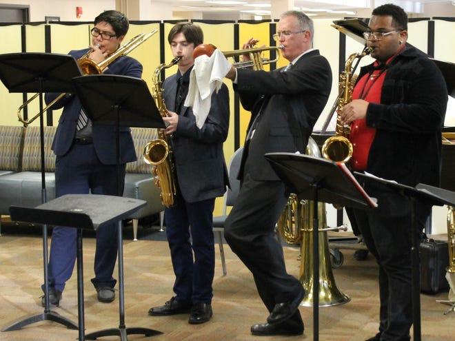 Dr. Edgar Crockett, third from left, creates a jazz scholarship for Black Hawk music students.