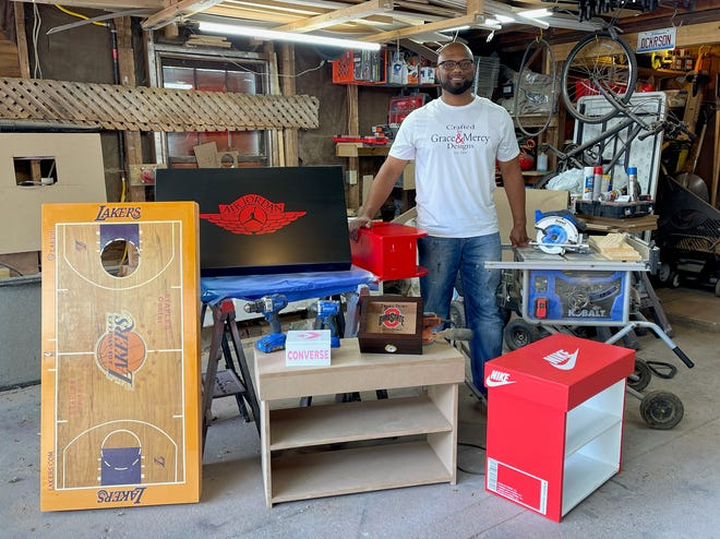 Elmer Dickerson, a Galesburg native now living in Peoria, stands with some of the woodworking projects he created through his business, Crafted by Grace and Mercy Designs.