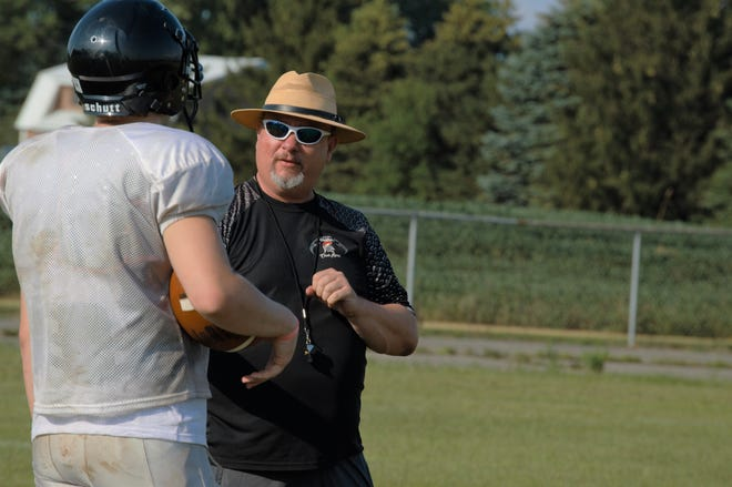 Waldron Head Coach Toney Roney instructs his players during a pre-season practice session.