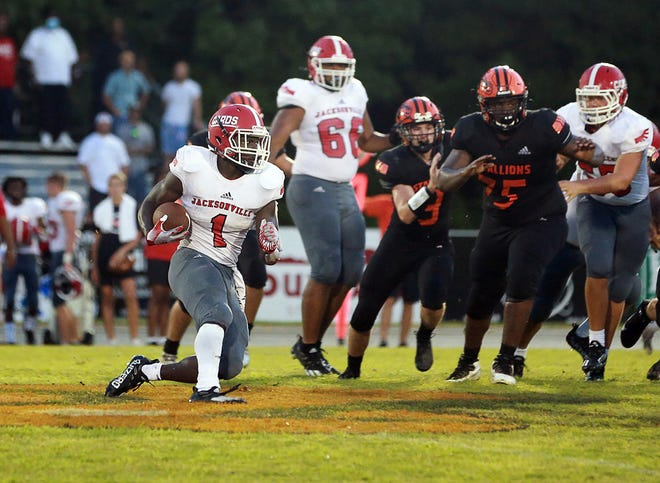Jacksonville's Curtez Echols (1) tries to find running room Friday night in the Cardinals' 42-7 victory at Southwest.  [John Althouse / The Daily News]