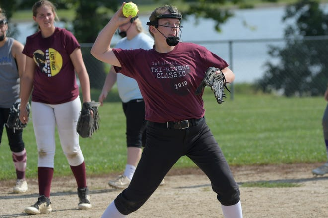 Schuyler County pitcher Kait Hatfield throws to first base during a fielding drill at practice.