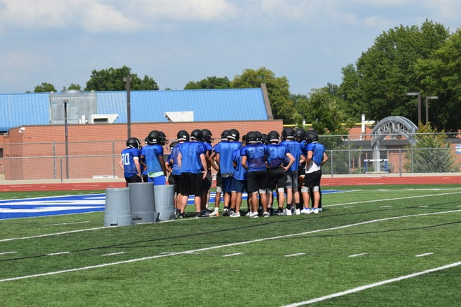 Shown are members of the Leavenworth High School football team preparing to start a drill during practice.