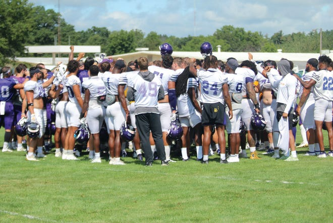 The Western Illinois football team huddles after a scrimmage on Saturday, August 21, 2021.
